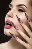 Beautiful girl with long nails and sensual lips Stock Photo
