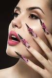 Beautiful girl with long nails and sensual lips stock photo