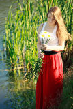 Beautiful girl in a long red skirt Stock Photos