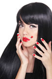 Beautiful girl with Long straight black hair. Red lips. Manicure Stock Photo