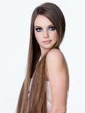 Beautiful girl with long straight hair Stock Photography