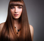 Beautiful girl with long straight hair Royalty Free Stock Photo