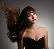 Beautiful girl with long straight hair Royalty Free Stock Image