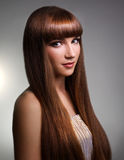 Beautiful girl with long straight hair Stock Image