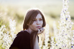 Beautiful girl with long, straight hair posing in the field Stock Image