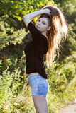 Beautiful girl with long, straight hair posing in the field Stock Images
