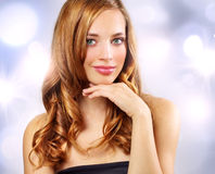 Beautiful girl with long wavy hair Stock Photo
