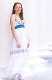 Beautiful girl in a long white columns. Near the Sarafan photography Royalty Free Stock Photos