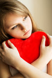 Beautiful girl longing for her beloved and keeps the heart Royalty Free Stock Image