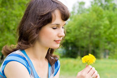 Beautiful Girl Looking At The Flowers Royalty Free Stock Photography