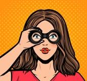 Beautiful girl looking through binoculars. Retro style pop art. Vector illustration stock illustration