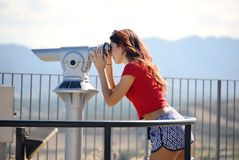 Beautiful girl looking landscape by coin binocular.  Stock Photos