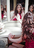 Beautiful girl looking in the mirror. Portrait of beautiful girl looking in the mirror stock photos