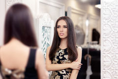 Beautiful Girl Looking in the Mirror and Trying on an Elegant Dress Stock Image