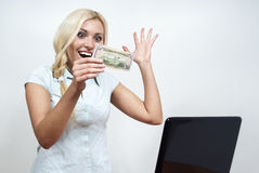 Beautiful girl are looking for money. Beautiful girl  are looking for money with a laptop Royalty Free Stock Photography