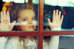 Beautiful girl looking out the window. Outside view Royalty Free Stock Images