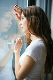 Beautiful girl looking  out of the window Royalty Free Stock Images