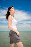 Beautiful girl looking skywards. Young beautiful girl in casual clothes looking skywards Royalty Free Stock Photo