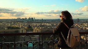 Beautiful girl looking from the top of Eiffel tower. stock video