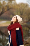 Beautiful girl looking up in Winter clothes Stock Photography