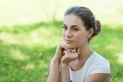Beautiful girl looks aside Royalty Free Stock Image