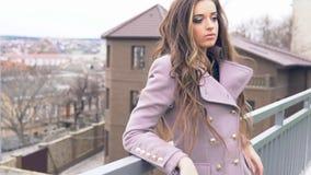 Beautiful girl looks at city walk. Beautiful girl in paltom looks at city walk stock footage