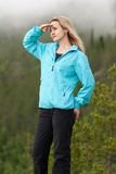 Beautiful girl looks into the distance. On the background of pine forest with fog Royalty Free Stock Photos