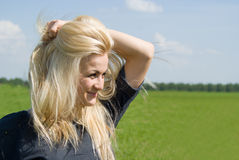 Beautiful girl looks in the distance Stock Images