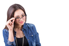 Beautiful girl looks over glasses holding frame Stock Photos