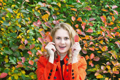 Beautiful girl looks of surprise. Beautiful young girl looks of surprise on a background of autumn color of the leaves Stock Photos