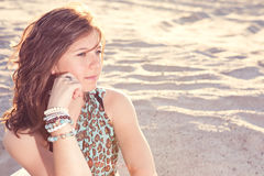 Beautiful girl looks wistfully Royalty Free Stock Image