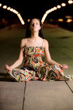 Beautiful girl in lotus pose Royalty Free Stock Photos