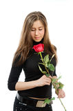 Beautiful girl in love holding a red rose Royalty Free Stock Photos