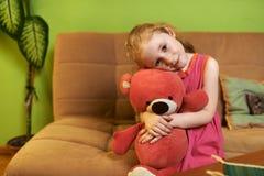 Beautiful girl loves  teddy bear Stock Photos