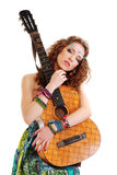 Beautiful Girl loving guitar Royalty Free Stock Images