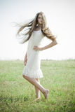 Beautiful girl with luxuriant hair Stock Images