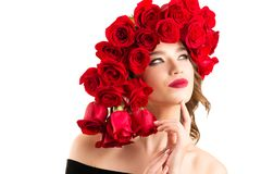 Beautiful girl with luxurious hairstyle of red roses royalty free stock photo