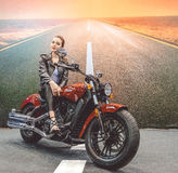 Beautiful girl and a luxurious motorcycle. Speed and freedom Stock Image