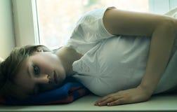 Beautiful Girl Lying And Longs Royalty Free Stock Photo