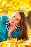 Beautiful girl lying in autumn leaves Royalty Free Stock Image