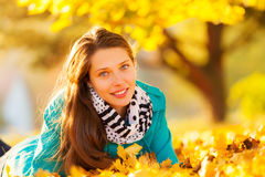 Beautiful girl lying in autumn leaves Royalty Free Stock Photography