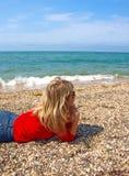 Beautiful girl lying on a beach Stock Photos