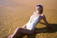 Beautiful girl lying beach Royalty Free Stock Images