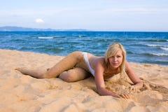 Beautiful girl lying on beach Royalty Free Stock Photography