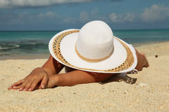 Beautiful girl, lying on the beach Royalty Free Stock Images