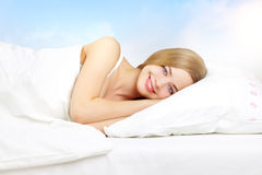 Beautiful girl lying on a bed Royalty Free Stock Photos