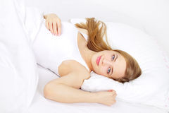 Beautiful girl lying on a bed Stock Image