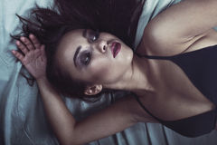 Beautiful girl lying in bed Stock Images