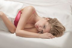 A beautiful girl lying on the bed Stock Photos