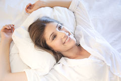 Beautiful girl lying in bed. A beautiful girllying in her bed Stock Photos